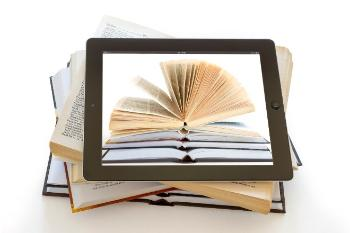 Tablet showing books on background of open books