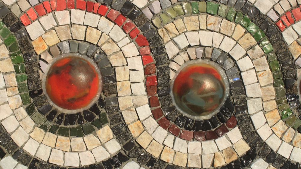 Mosaic tiles showing a pattern of circles and waves
