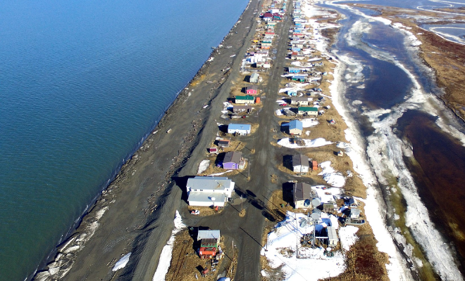 Aerial view of small settlement by the sea in Alaska