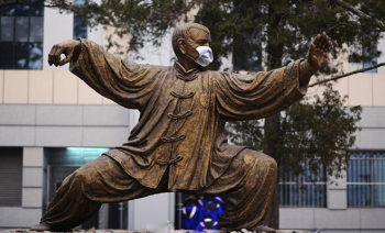 Beijing University statue of a taijiquan practitioner wearing a face mask