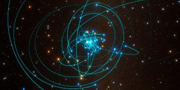 Image of celestial bodies floating in space surrounding the gravitational pull of a black hole