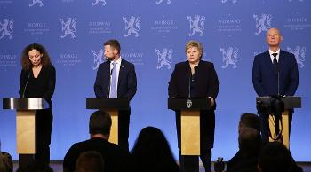 Four people at a press conference.