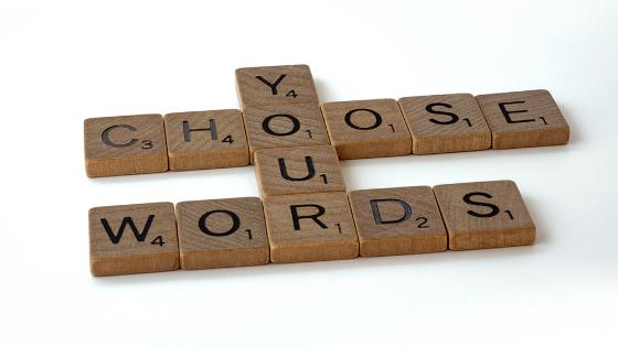 "Scrabble tiles spelling ""Choose your words"""