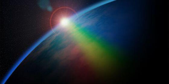 Light shining on a planet. Illustration.