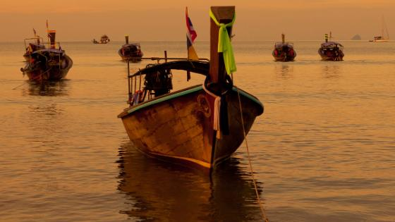 Fishing boats in the ocean in East-Asia. Heading. Photo.