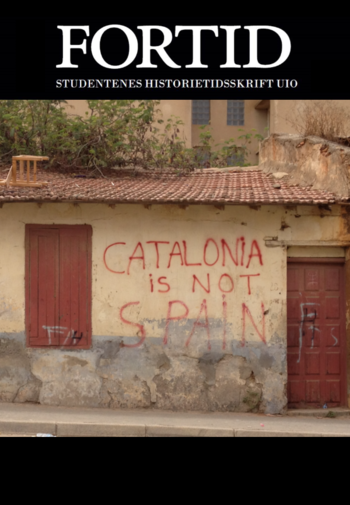 "A yellow brick wall tagged with ""Catalonia is not Spain"" in red"