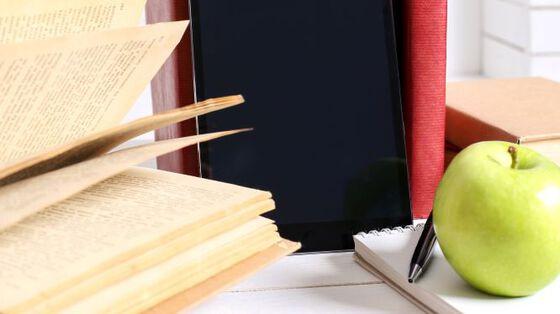 Ipad, books, pencil and apple