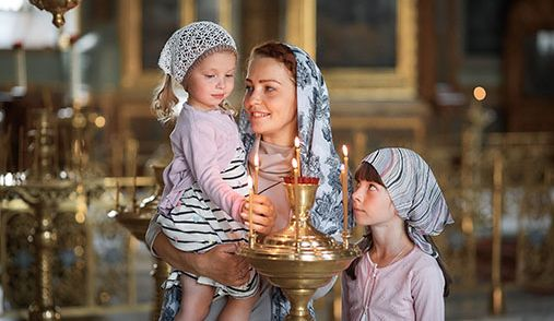 Russian mother and children in Orthodox church