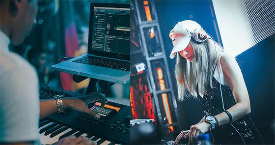 Mann spiller keyboard foran laptop og kvinne spiller musikk på elektronisk verktøy.
