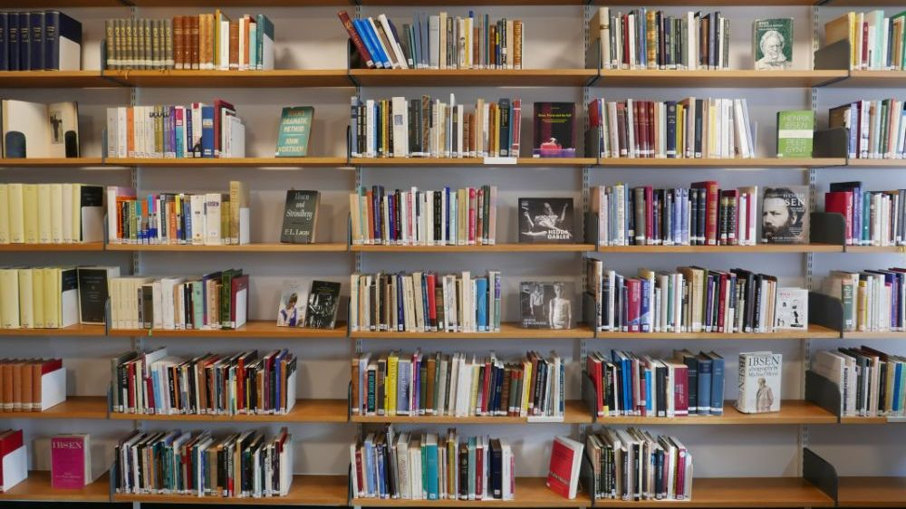 A bookshelf filled with Ibsen publications