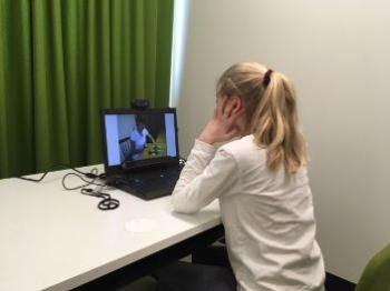Child is doing a test with an eye tracker