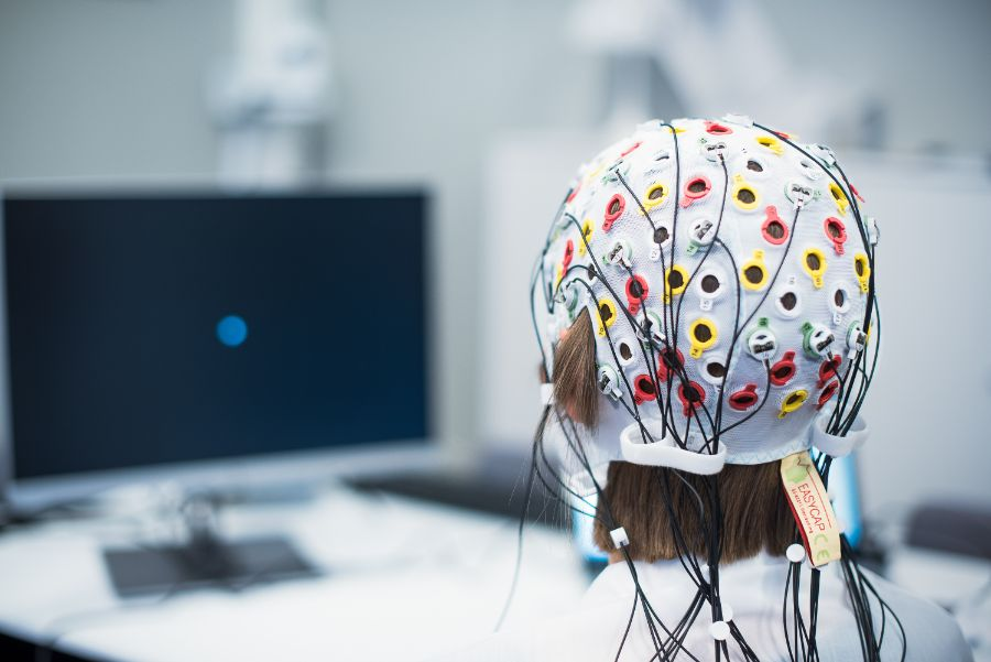 Woman wearing an EEG cap